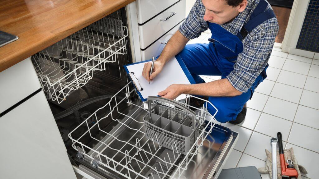 plumber inspecting dishwasher