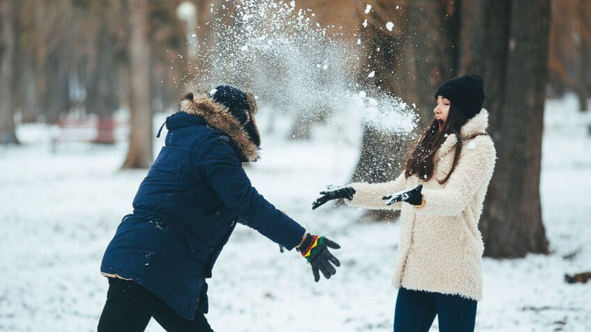 guy and girl playing in snow