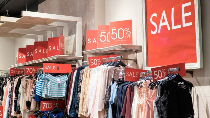 red sale signs in a clothing store