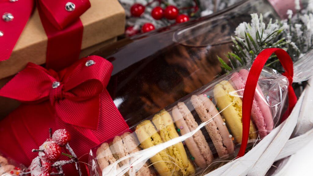 macarons wrapped in plastic and bundled in a christmas basket