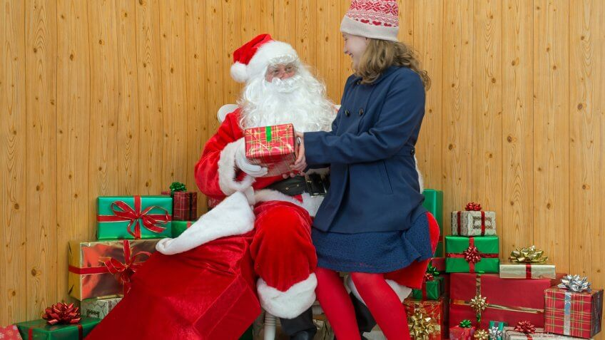 girl sitting on santas lap