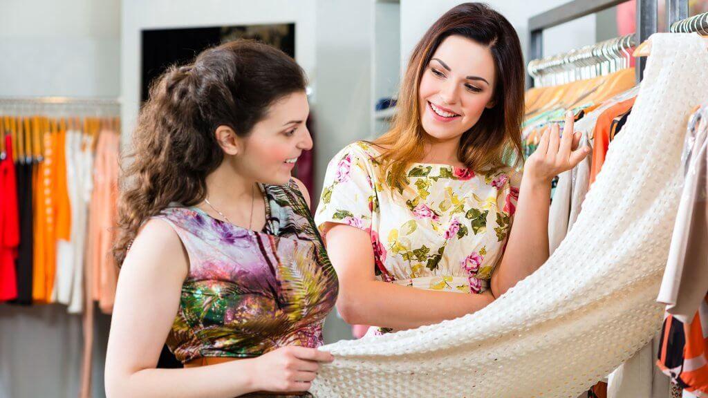 two women dress shopping