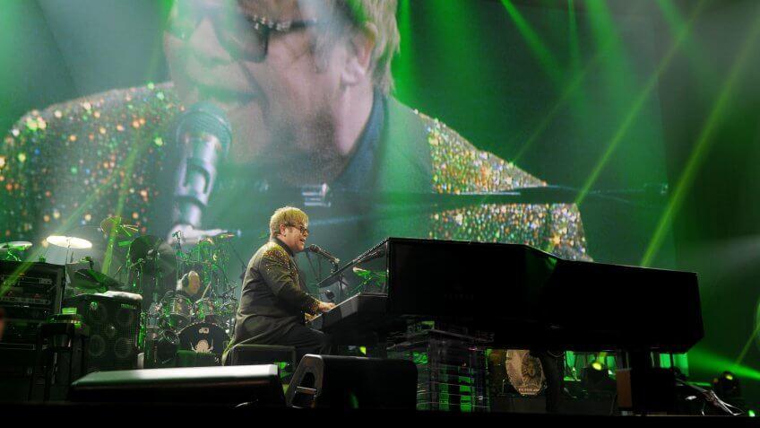 "LAS VEGAS, NV - SEPTEMBER 28:  Elton John performs during his Triumphant return with ""Million Dollar Piano"" at Caesars Palace on September 28, 2011 in Las Vegas, Nevada."