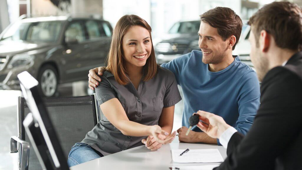 man and woman purchasing car