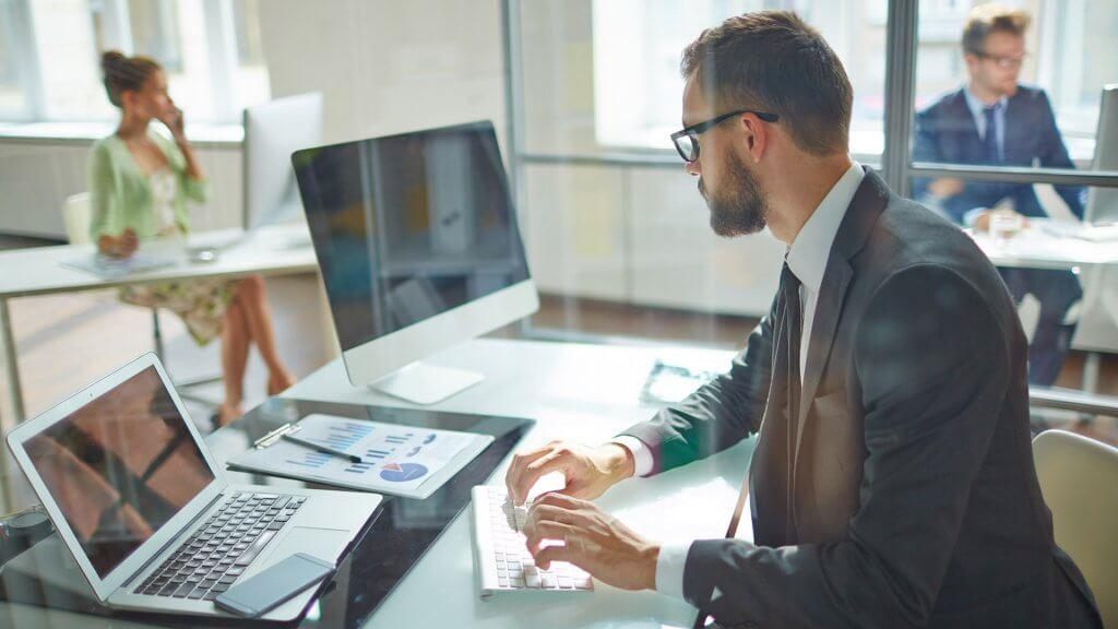 businessman working at his office desk