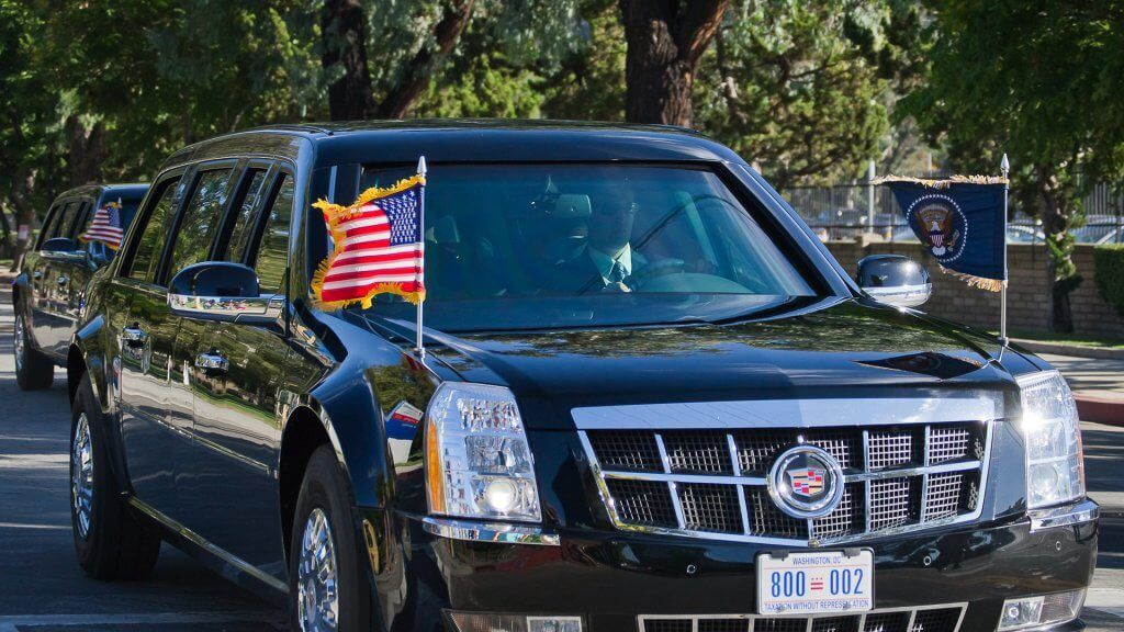 Cadillac limo with American flags