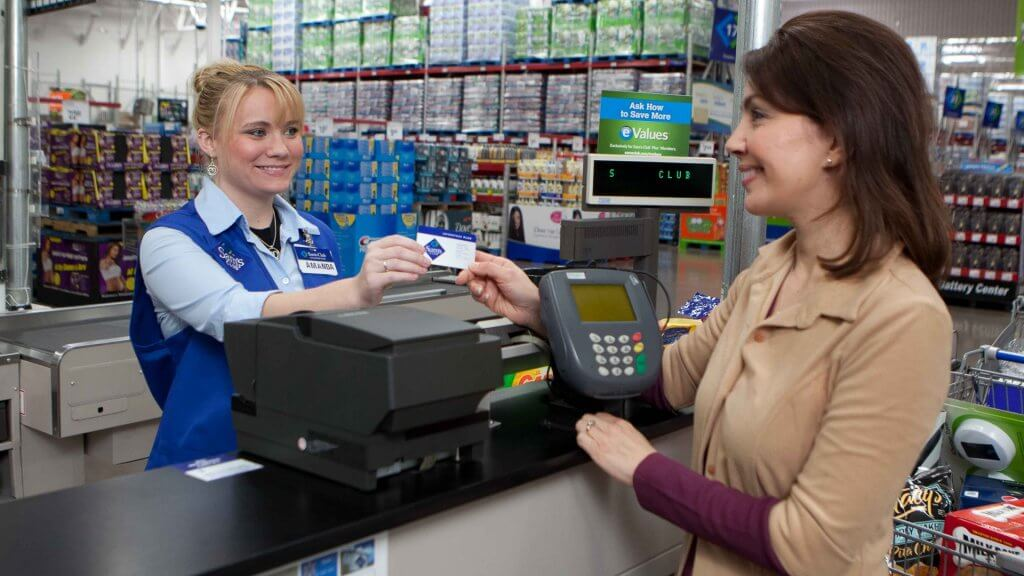 sams club cashier handing card to woman