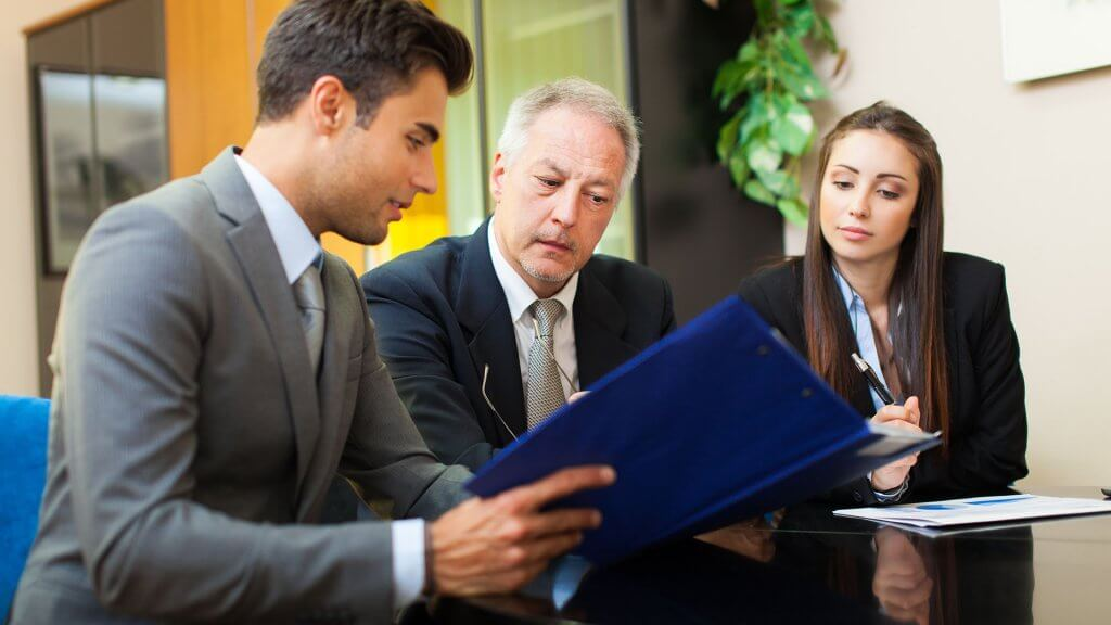 business associates discussing paperwork
