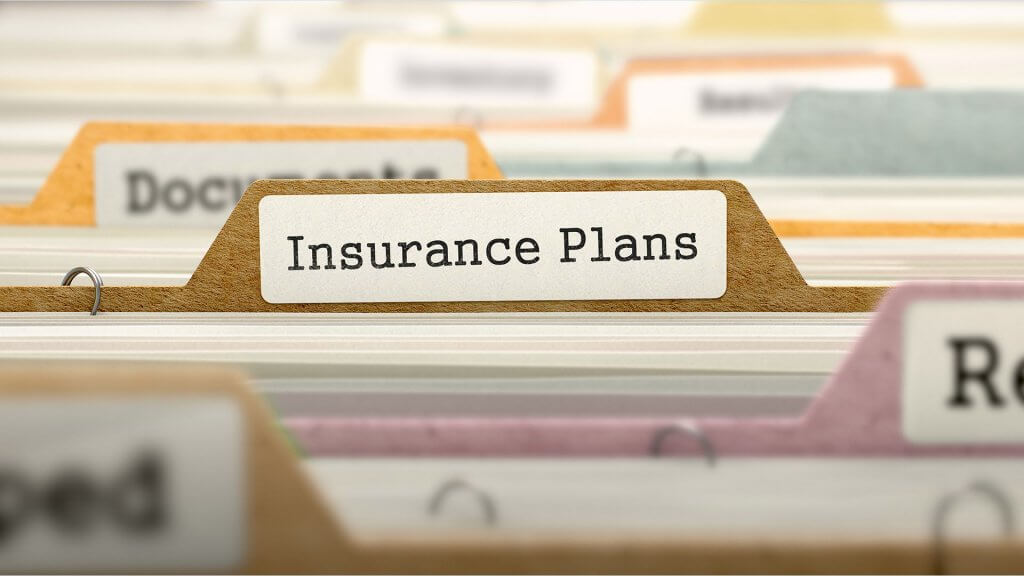 insurance plans label on a folder
