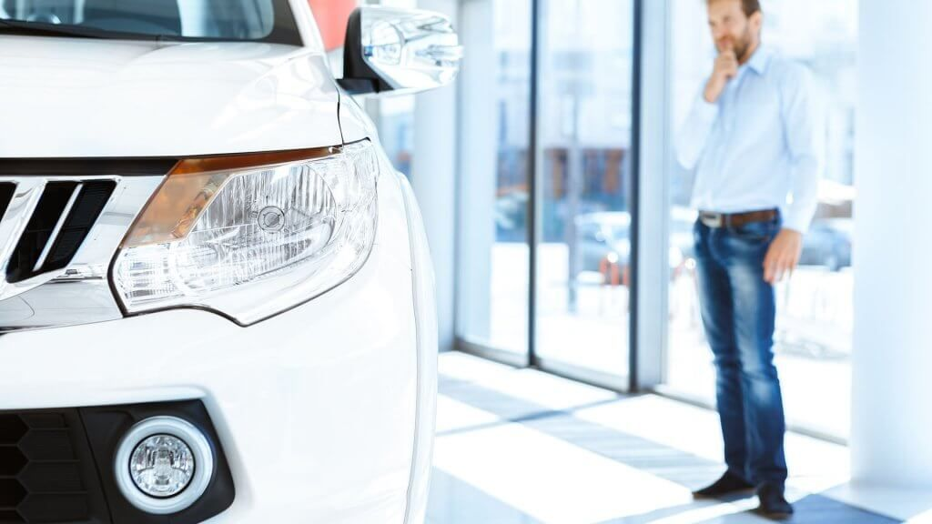 potential car customer gazing at car