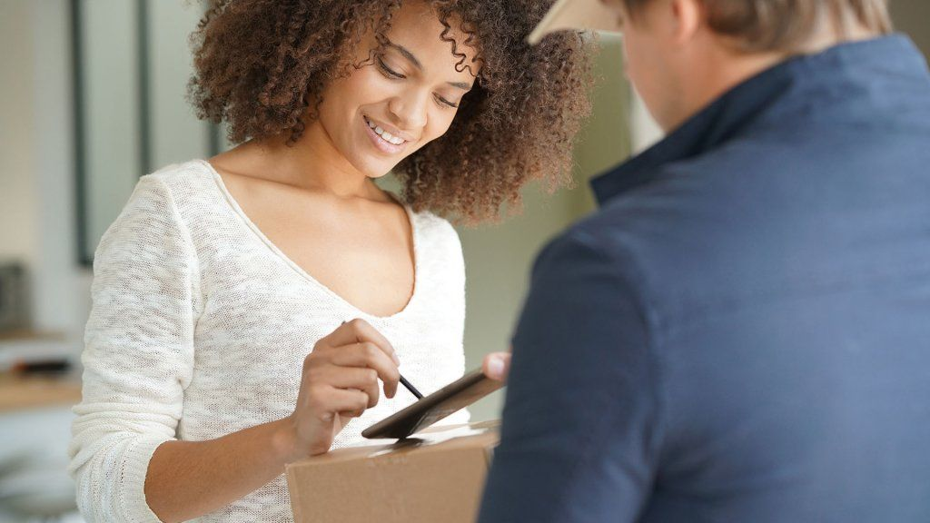 woman signing for package