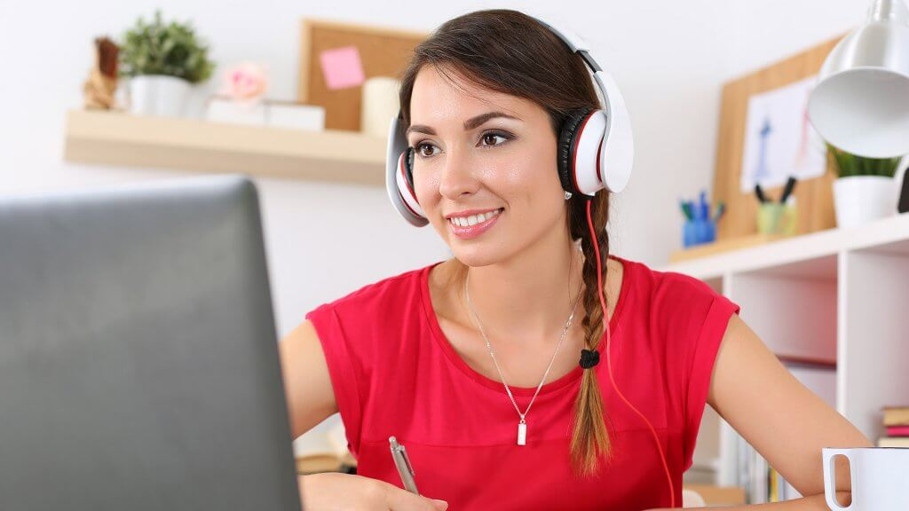 woman with headphones on computer