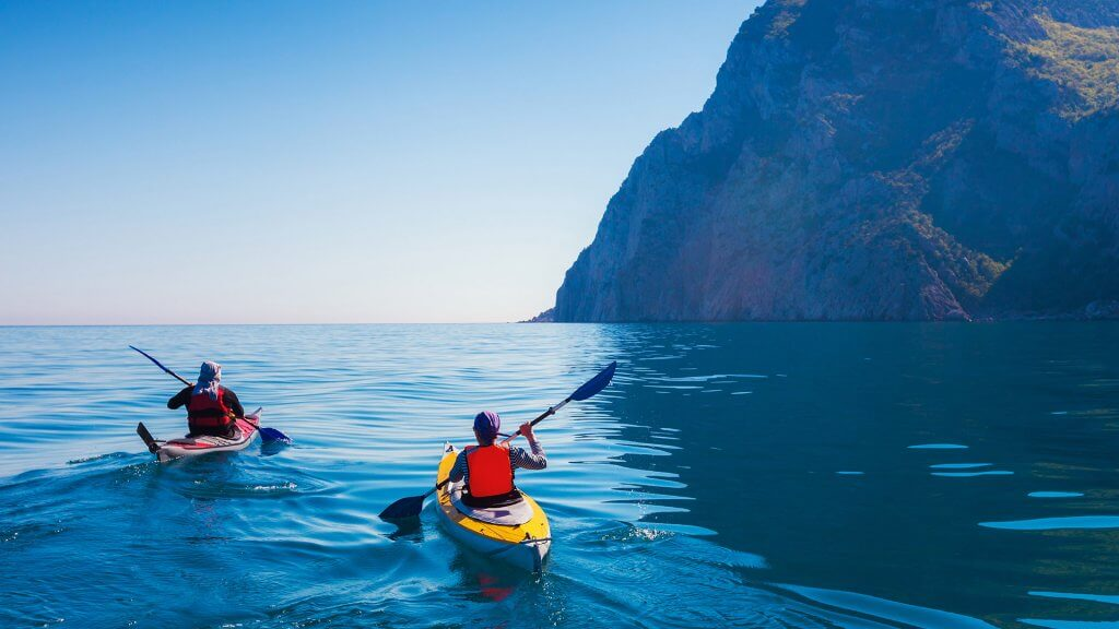 kayakers on the ocean