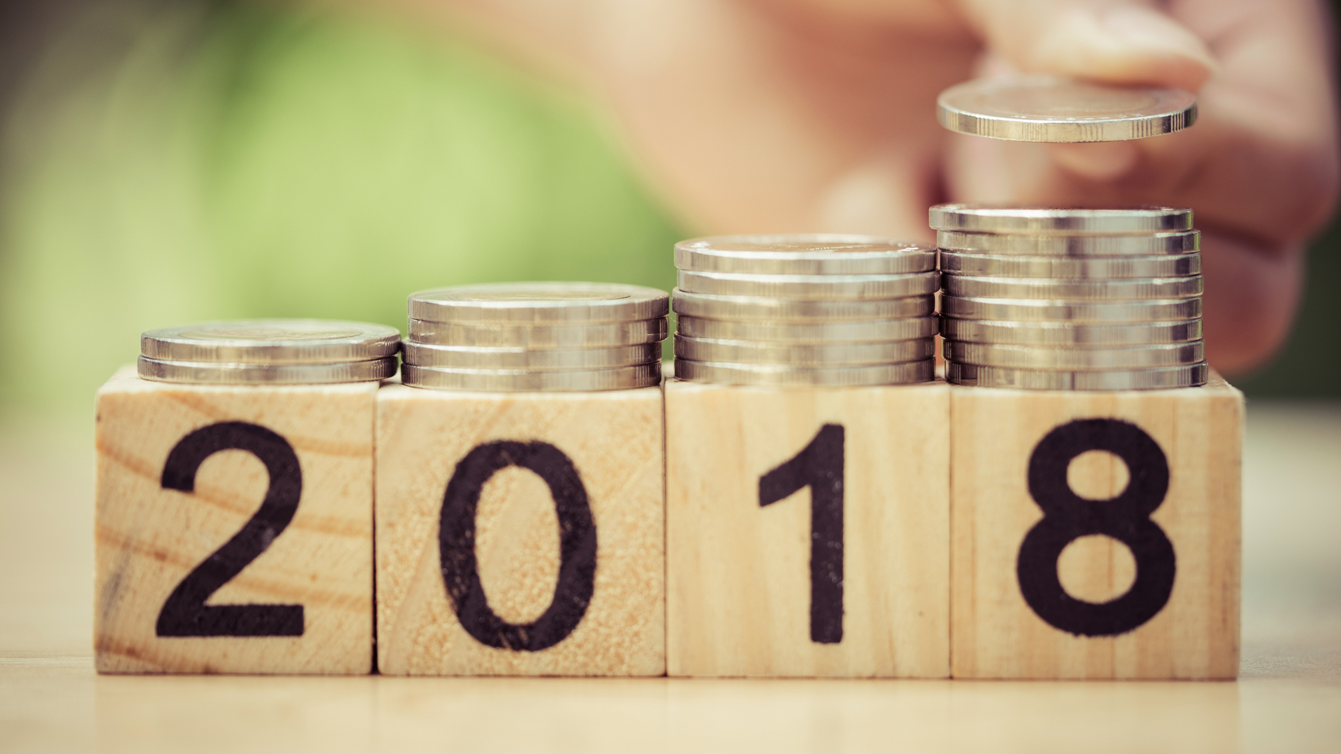 7 fastest growing stocks since 2000 gobankingrates hand putting coins to stack of coins on wooden block with text 2018 buycottarizona Gallery