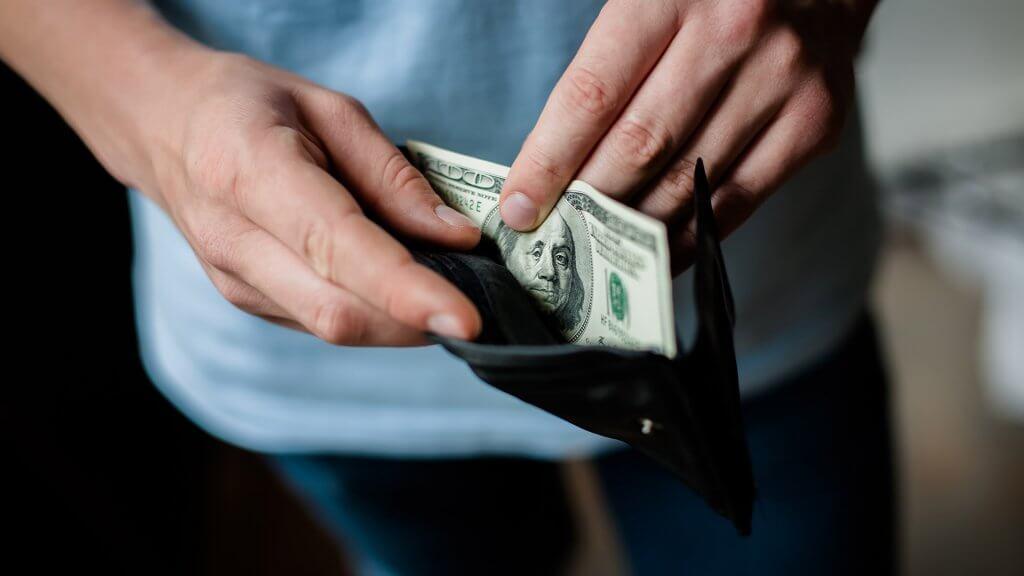 100 bill in wallet