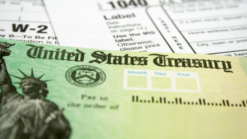 Tax Refund Check with W-2 and 1040 U.