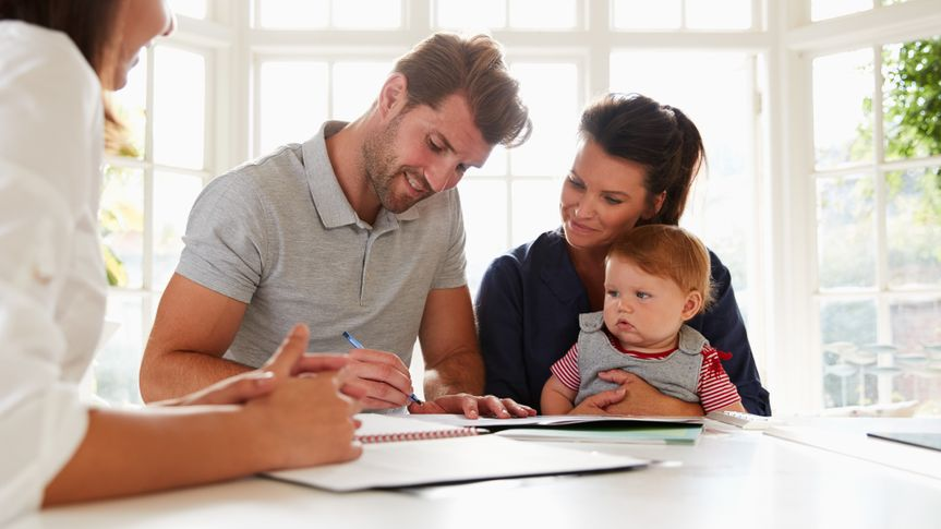 Family With Baby Meeting Financial Advisor At Home.