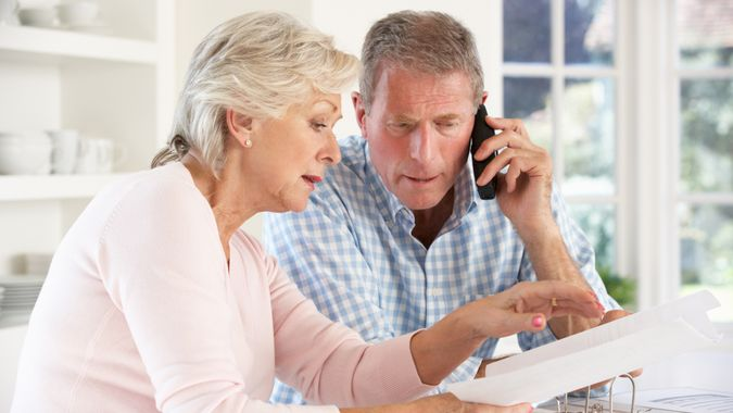 Retired couple with household bills.