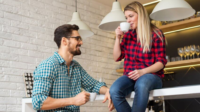 couple drinking coffee in house