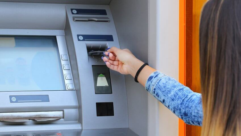 woman using an atm machine