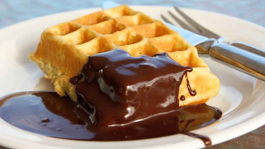 Belgian waffle with chocolate cream on the plate.