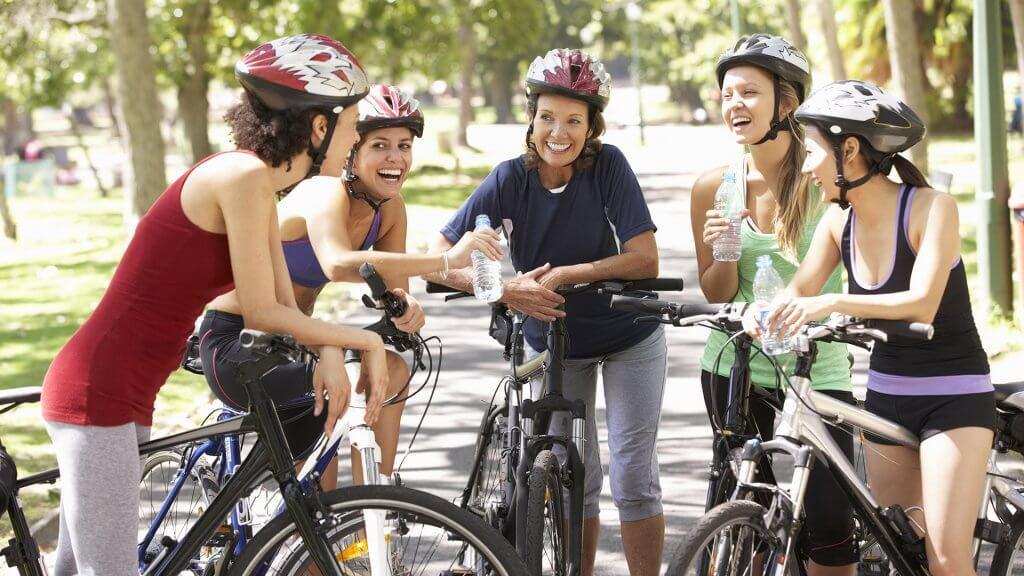 group of women on bicycles gathered together