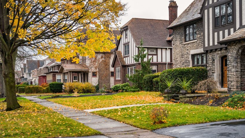 Photo of a row of homes in a residential district in downtown Niagara Falls, New York State, USA during Autumn.