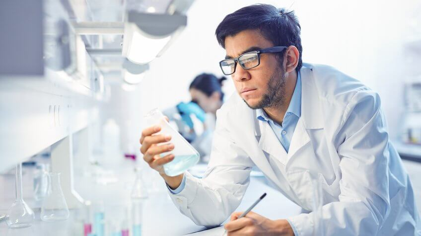 man in lab coat conducting tests