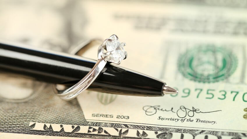 US dollar with pen and ring