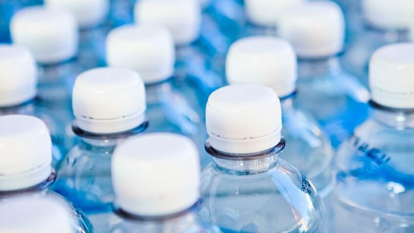 Water bottles on a conveyor belt at a bottling plant.