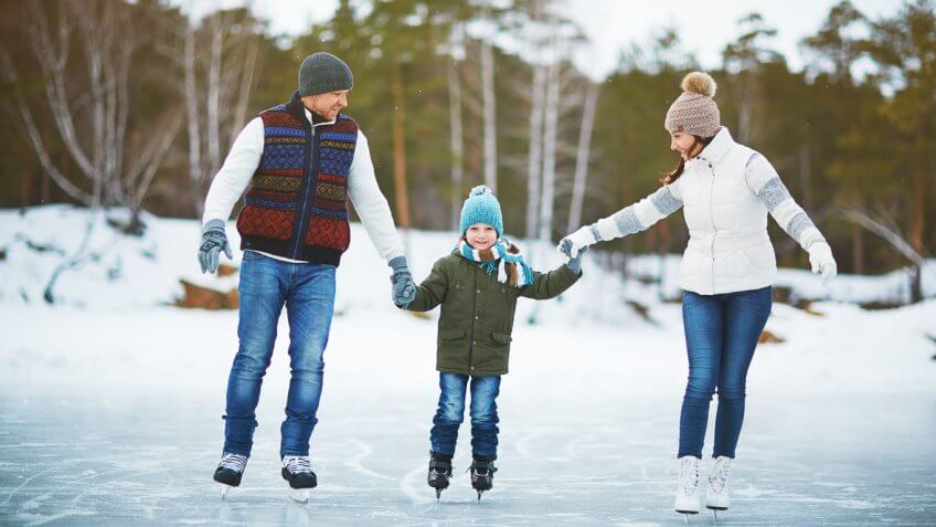 young family and daughter ice skating
