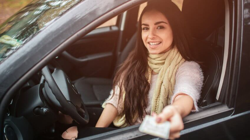 Woman showing driving license.