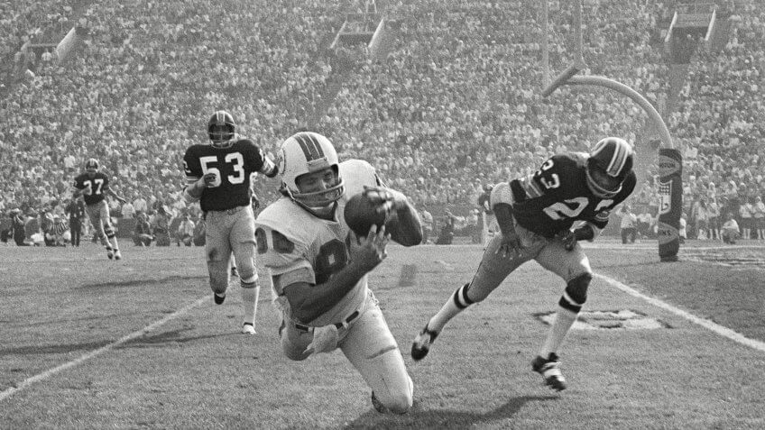 Jim Mandich; Harold McLinton; Brig Owens Miami Dolphins Jim Mandich makes a diving catch of a 19-yard Bob Griese pass near the goal line during the second quarter, setting up the Dolphins second touchdown in Super Bowl VII, in Los Angeles.