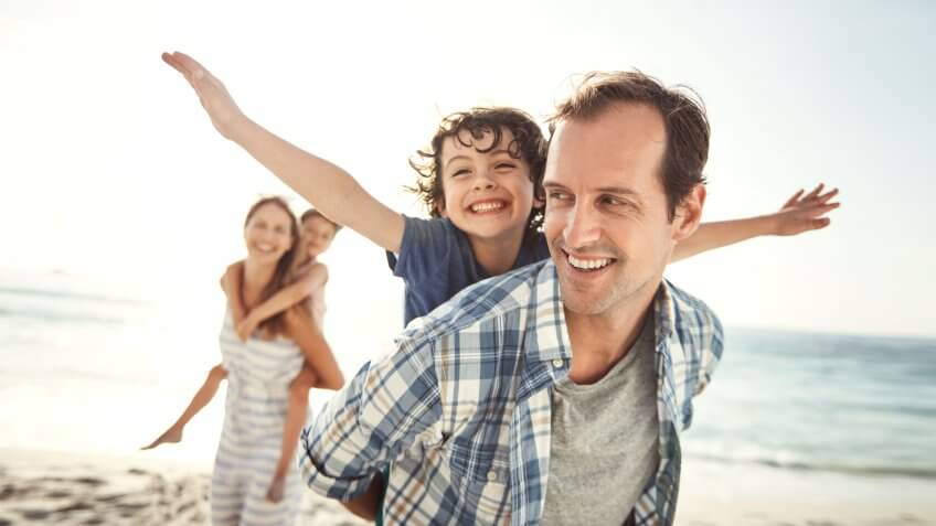 Shot of a happy young family having fun at the beach.