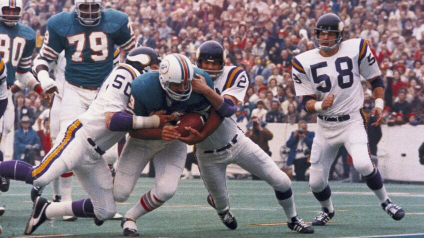 Associated Press Sports California United States APHS 54554 Miami Dolphins' Larry Csonka racing through the Minnesota Vikings line.