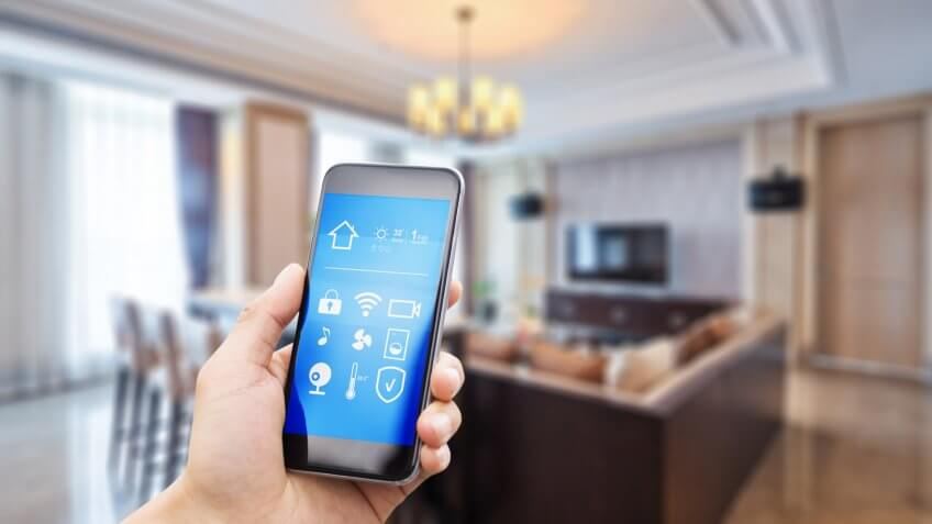 smart phone with apps in luxury living room.