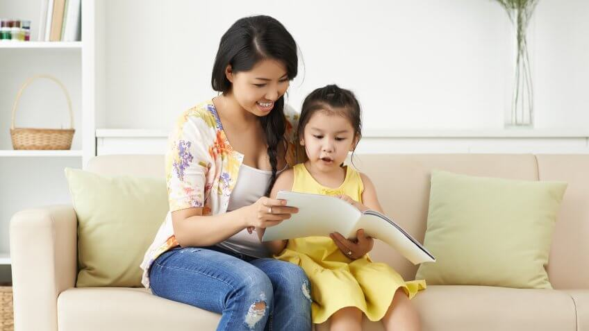asian mom reading with her daughter