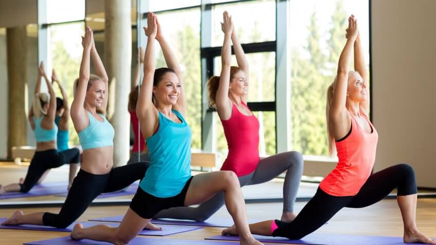 group of young women doing yoga