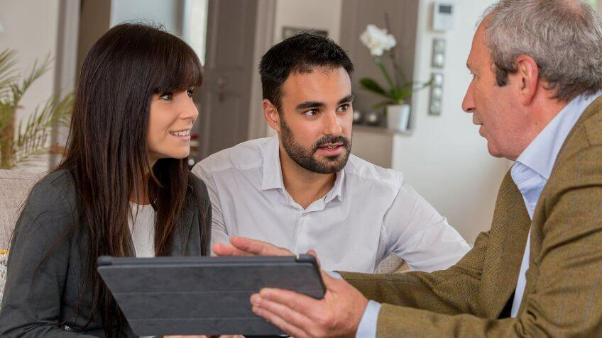 younger couple speaking to an adviser
