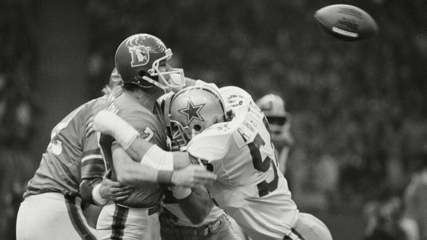 Craig Morton Denver quarterback Craig Morton is hit by Randy White (54) of Dallas after a pass that was intercepted and eventually led to a Dallas touchdown in first quarter Super Bowl XII action in New OrleansSuper Bowl Cowboys Broncos, New Orleans, USA.