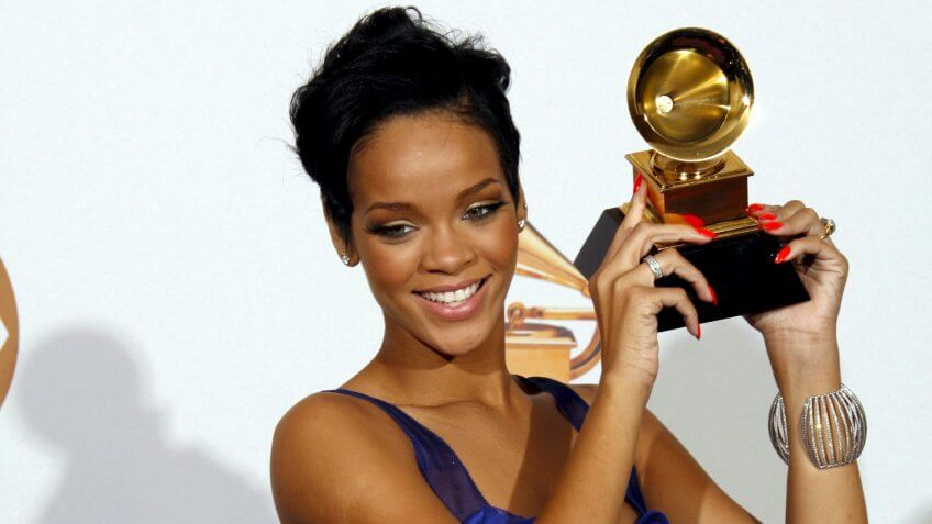 Mandatory Credit: Photo by Andrew Gombert/EPA/REX/Shutterstock (7832065ap)U S Singer Rihanna Holds Up Her Grammy Award During the 50th Annual Grammy Awards at the Staples Center in Los Angeles California Usa 10 February 2008Usa Grammy Awards - Feb 2008.
