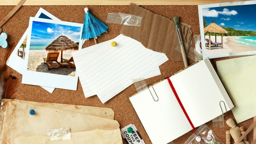 vacation corkboard with pictures, journal, note cards