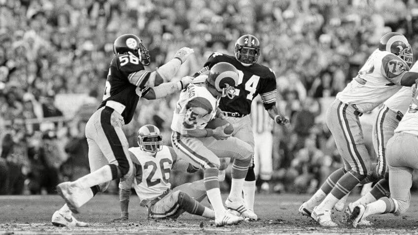 Robin Cole, Vince Ferragamo Rams quarterback Vince Ferragamo (15) prepares to pass but never gets the ball past Steelers' Robin Cole (56), during Super Bowl XIV action at the Rose Bowl in Pasadena, Calif.