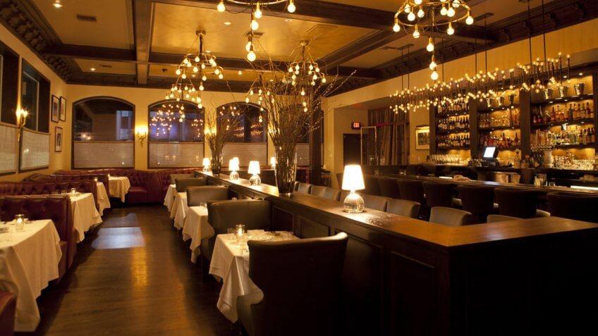 inside of a fancy, dim restaurant Crossroads Kitchen