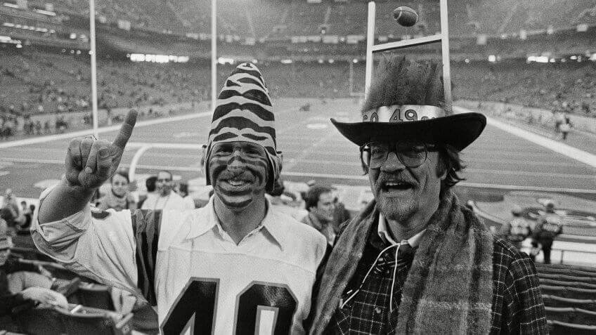 Mark Elmlinger, left, from Cincinnati, wears tiger stripes on his face and a Bengals conehead hat, as he is joined in Pontiac's Silverdome on by San Francisco 49ers fan Ed Schmitt, of Palo Alto, Calif.