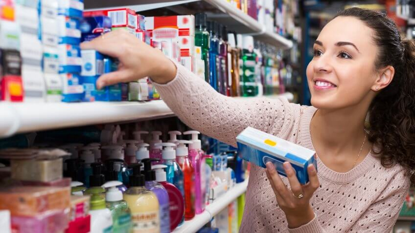 woman in a store buying toiletries