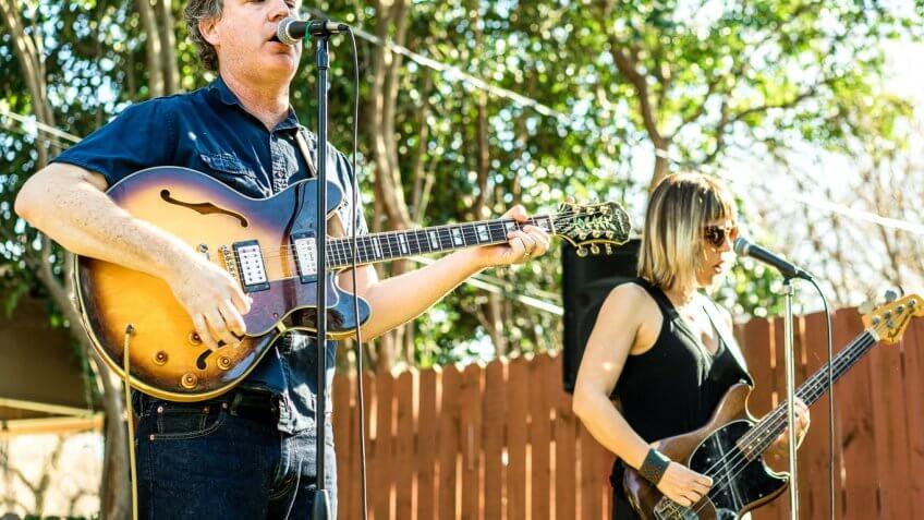 musicians singer guitarists performing outdoor