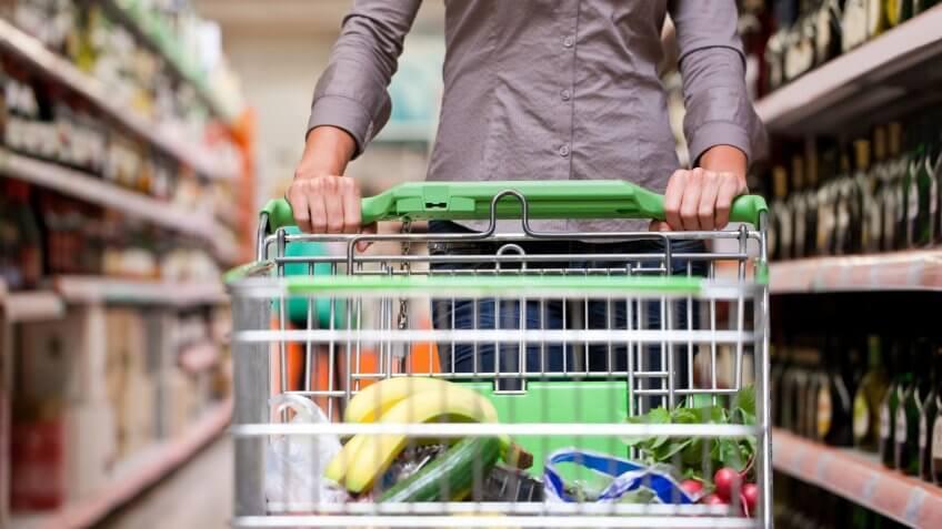 man pushing grocery cart