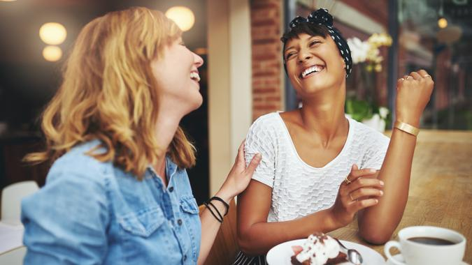 two women hanging out over coffee and cake