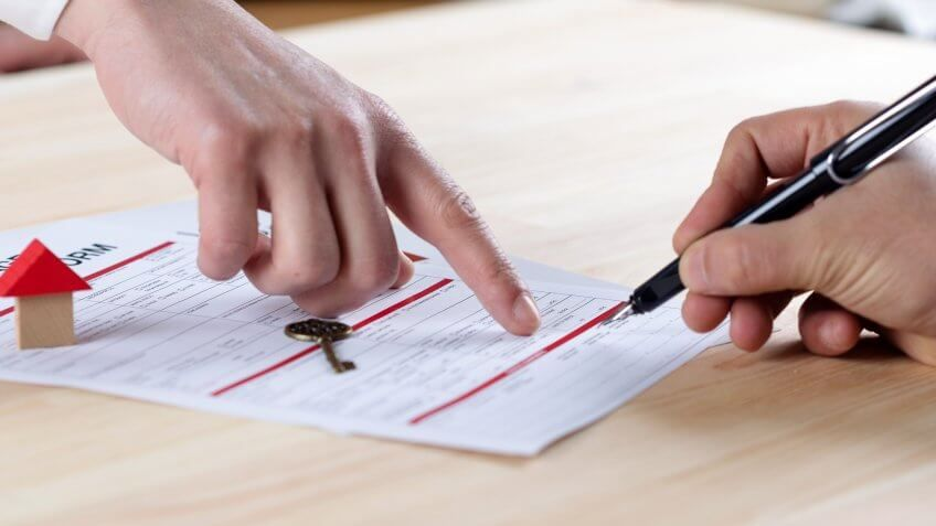 man signing papers for home